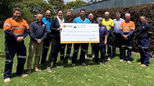 TDHS CEO Rebecca Van Wollingen accepts the cheque from representatives of Lochard Energy and its subcontractors