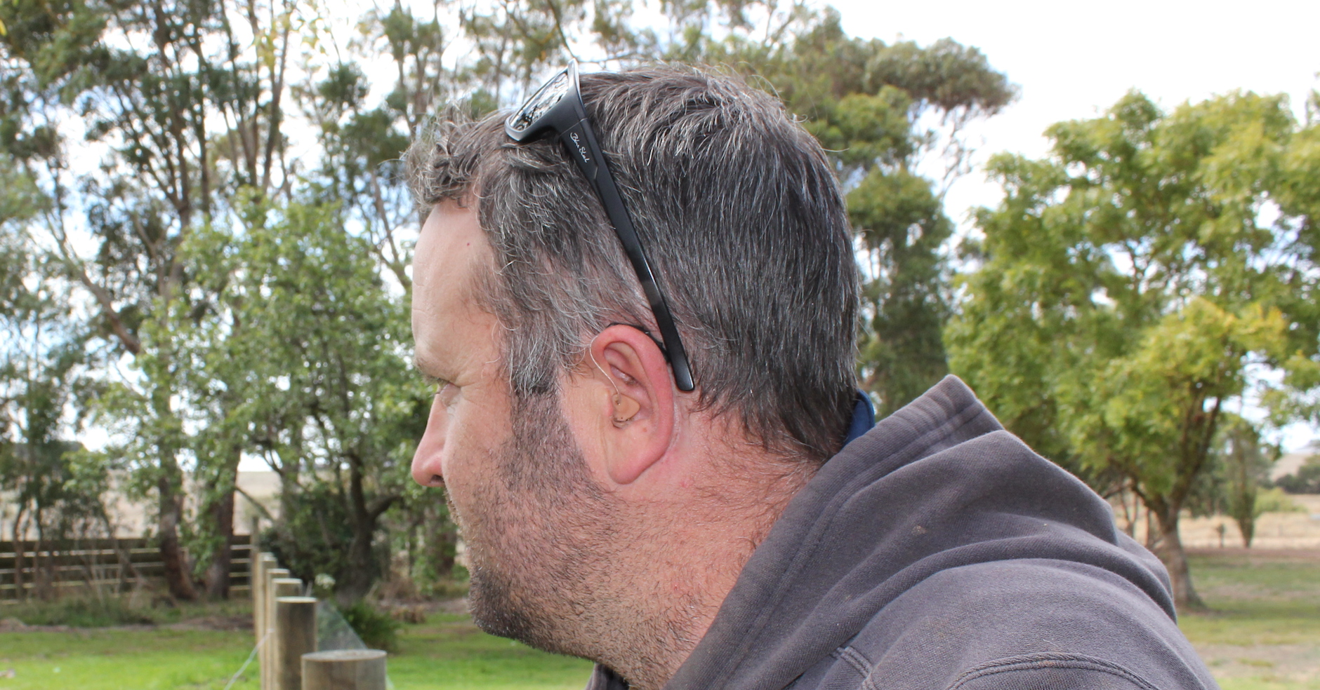 Jay Wynd's hearing aid is barely noticeable.